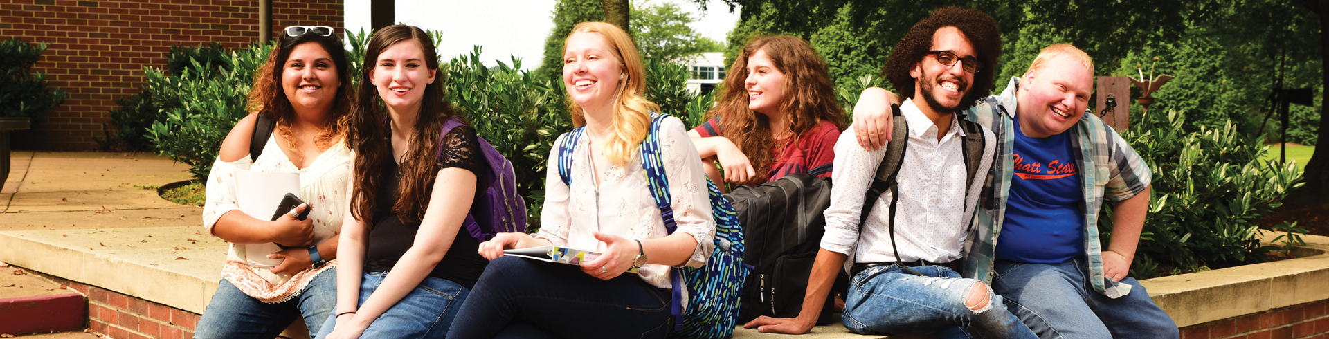 Photo of students sitting in courtyard