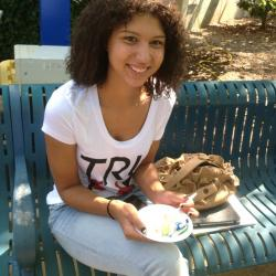 Tn Promise student enjoys a piece of 50th Birthday cake for the college