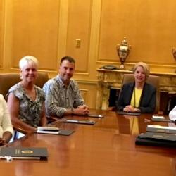 new Chattanooga State Alumni Board members seated left to right at board room table: Dr. Jared Bigham, Morgan Smith, Sherri Shackleford, Dennis Tumlin, Dr. Flora Tydings, Jerry Wagner, Tabatha Armour and Gary Ainscough.