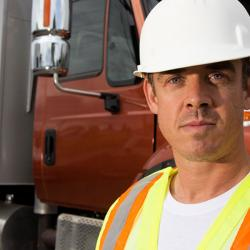man in front of dump truck