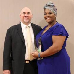 delnita evans with apca award