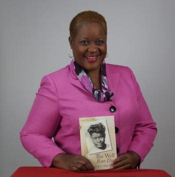 Pictured, Linda Murray Bullard –alum, writer, speaker, entrepreneur--holding her book The Well Ran Dry