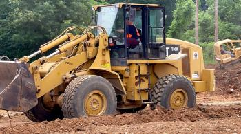 heavy equipment being used by students