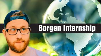 jake bolden looking at a world globe in a forest with the words borgen internship