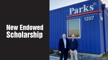 larry and robert parks in front of their company building