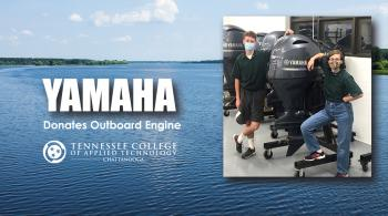 chattstate students with newly donated yamaha motor against a lake background