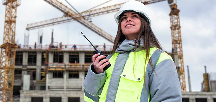 Woman communicates on a construction site